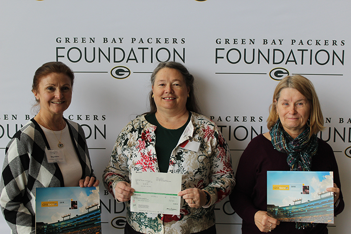 Port Washington Senior Center Accepting The Green Back Packer Foundation Grant